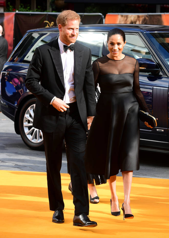 Meghan Markle wore a black midi dress with sheer sleeves for the premiere