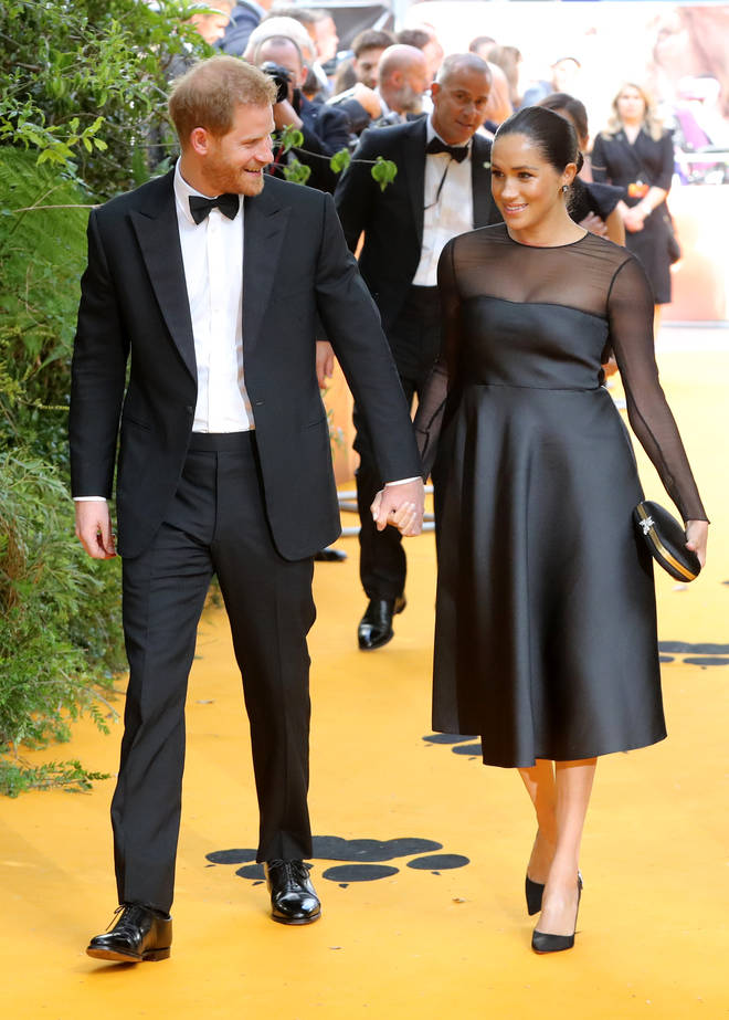 The couple walked the yellow carpet hand-in-hand