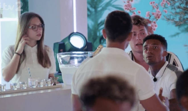 The bar girl was seen right behind Anton and the boys in many of the scenes