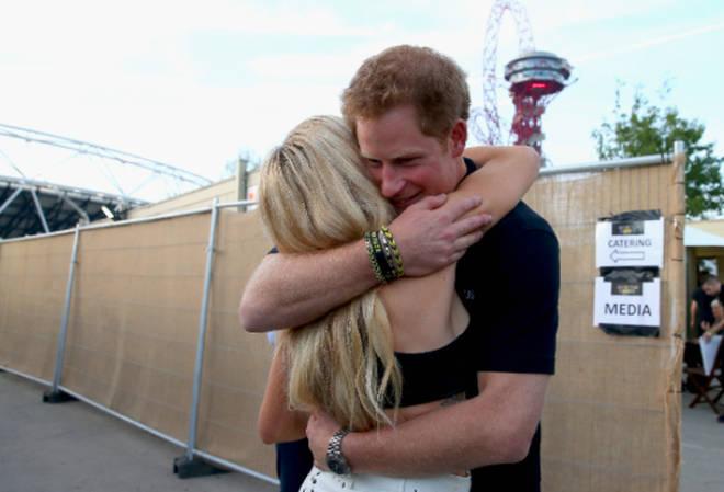 Prince Harry and Ellie Goulding hug