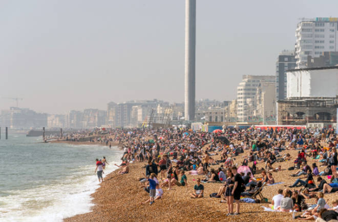 A packed Brighton beach in the sunshine
