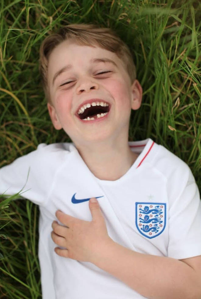 The new pictures of Prince George show him laughing while wearing an England Football shirt