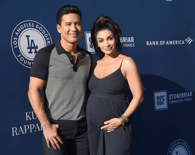 Mario Lopez with his wife Courtney