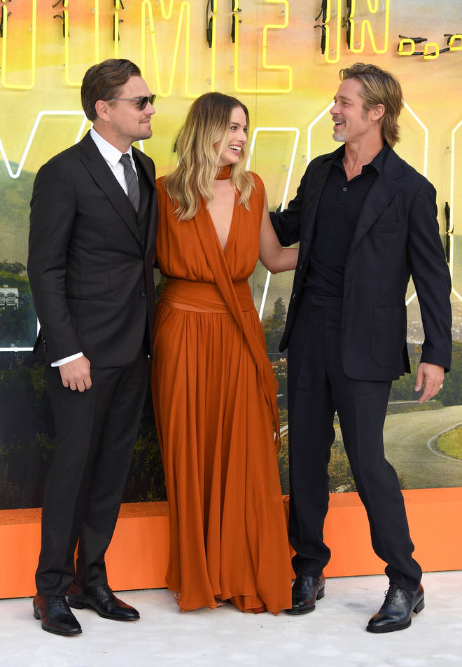 Leo, 44, looked dapper in a smart suit as he posed next to good friend Brand Pitt, 55, also dressed smart for the premiere