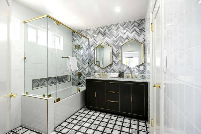 It boasted three bathrooms with interesting tiles