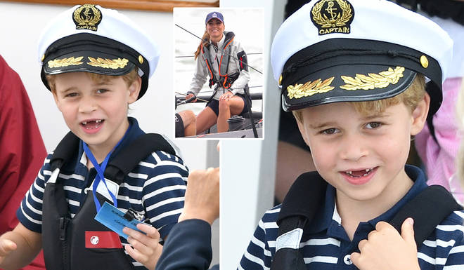 Prince George looked sweet in a Captain's hat as he watched his parents from afar