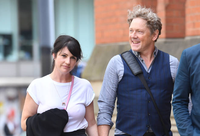 Mark smiles with partner Laura Norton after being cleared of assault earlier this month