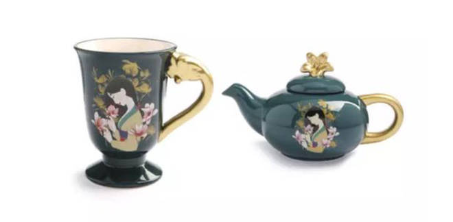 The collection includes mugs and a teapot