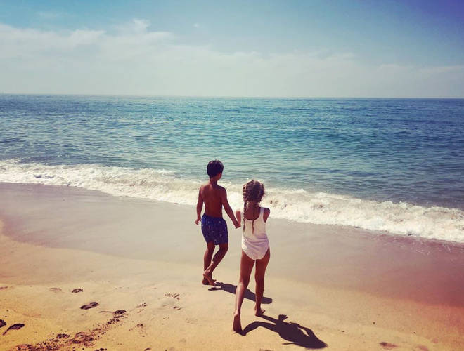 Belle and Harry, Holly's eldest children, played on the beach in the snap