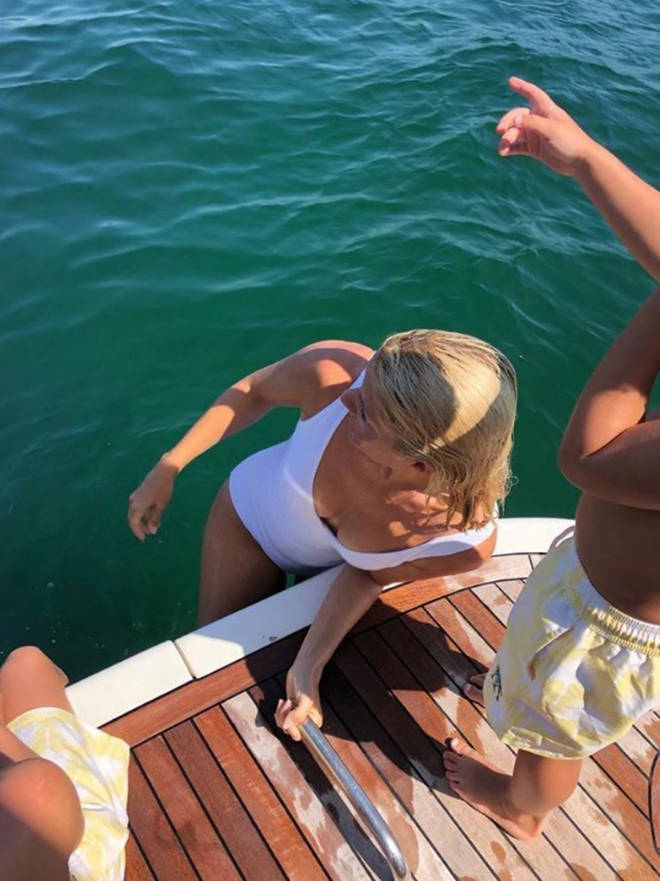 Earlier in the summer, Holly shared a picture of herself and her family enjoying some time at sea on a yacht