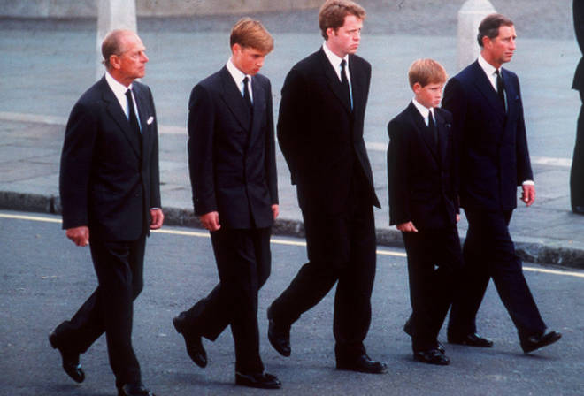 Princes William and Harry walk behind the coffin of their mother Princess Diana