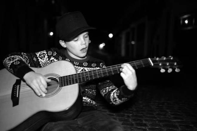14-year-old Cruz loves music and is often pictured singing or playing guitar