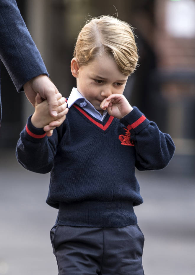 Prince George looked shy on his first day at school