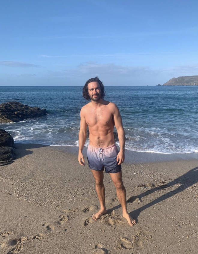 Joe posed on the beach in Devon and looked incredible