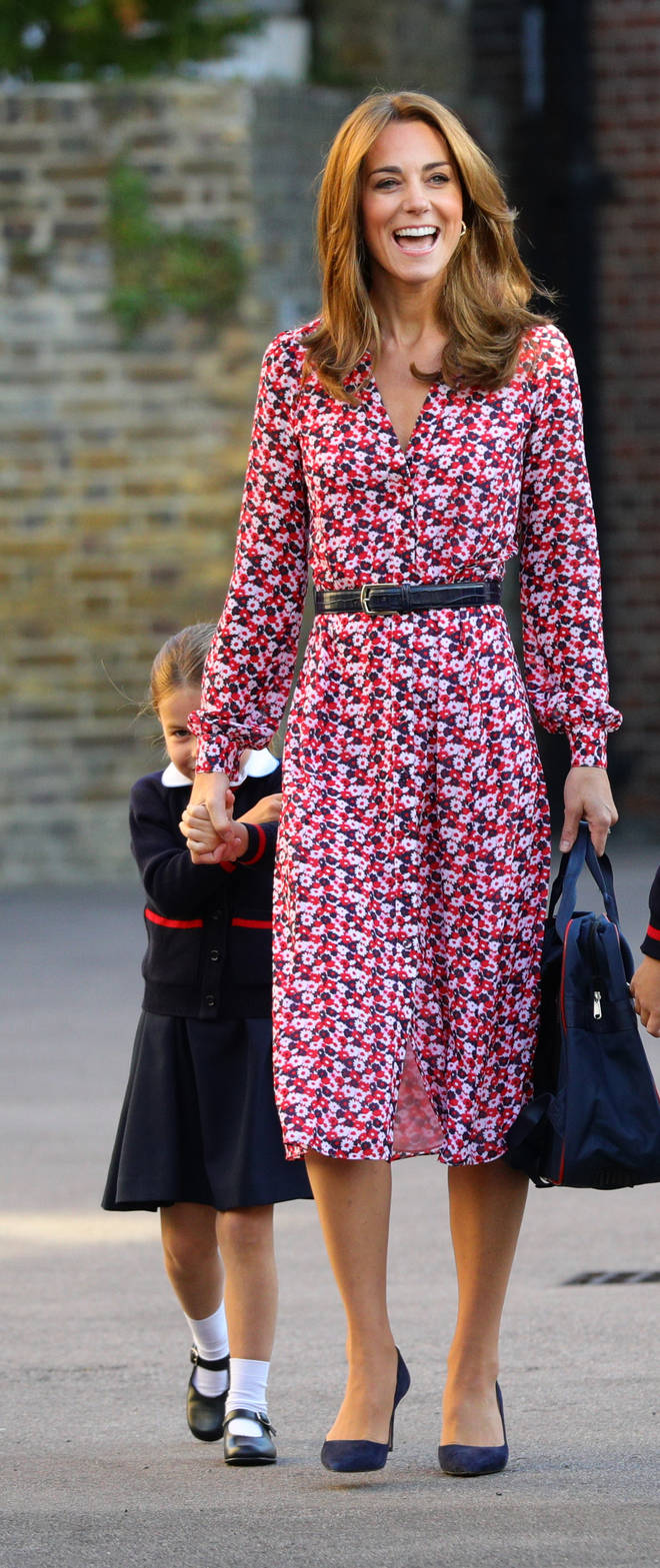 Princess Charlotte hid behind her mother as they approached the school