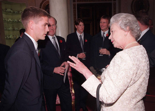 Ascot wasn't the only time Michael met the queen, pictured meeting Her Majesty in 1998