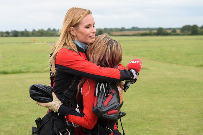 Amanda hugs Charlotte, 17, who was doing the jump in memory of her late mum