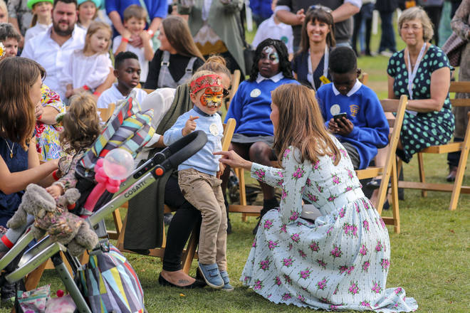 The Duchess of Cambridge attended a festival held in the gardens, where she got a chance to talk to many families