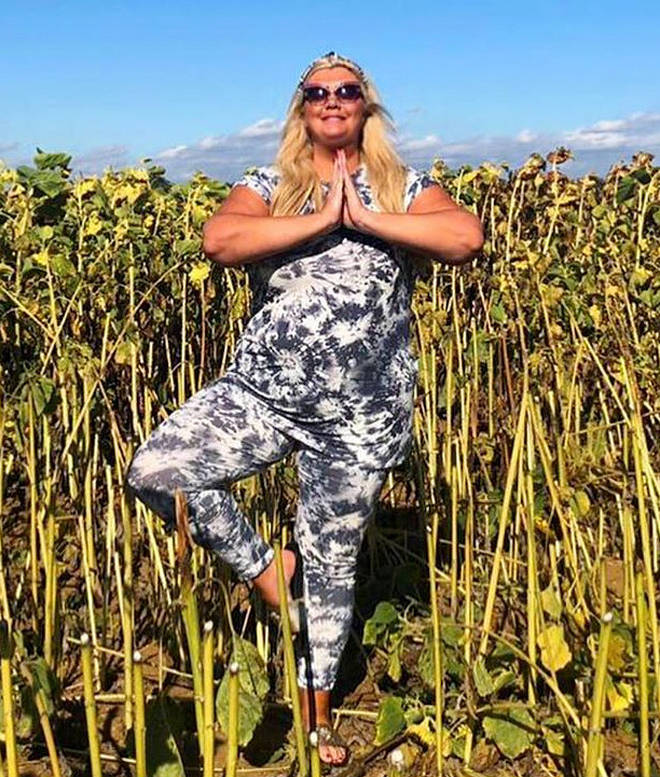 Gemma posed in a field of flowers for the zen photo