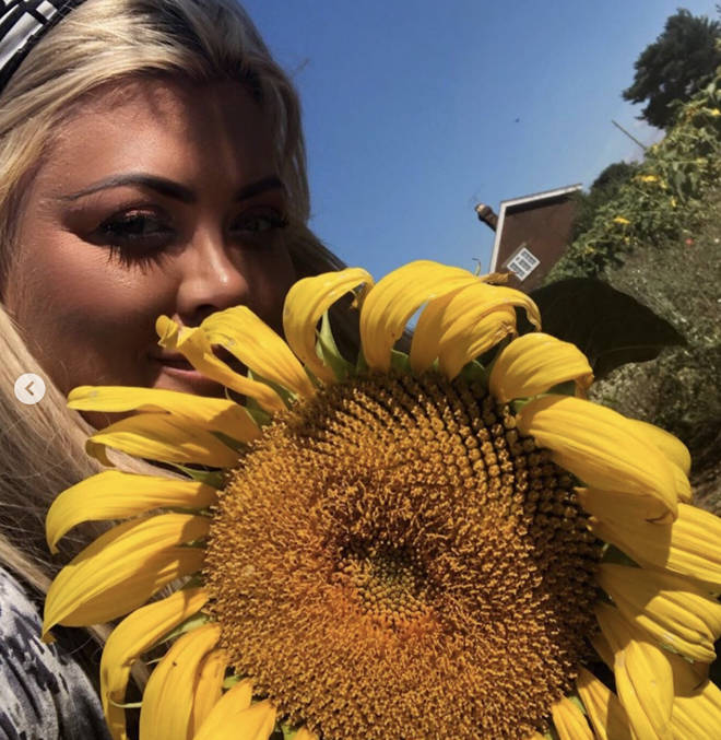 Gemma posed with a sunflower for a sunny snap