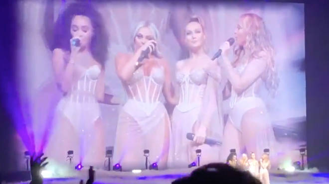 Her bandmates comforted her as she got emotional on stage
