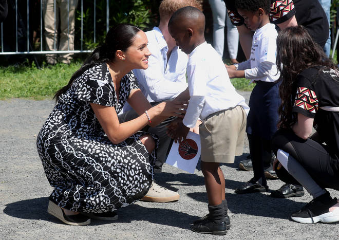 Meghan Markle embraced the children as they arrived in Cape Town