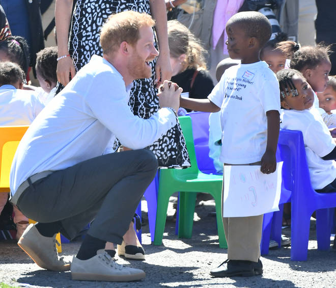 Prince Harry also let his playful side out as they arrived at their first engagement