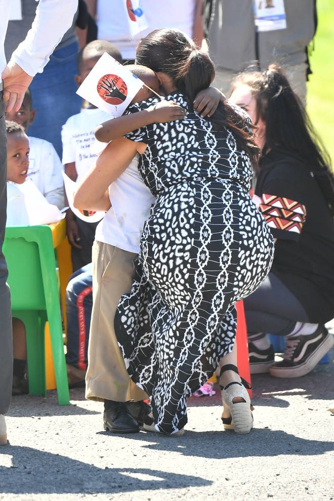The Duchess of Sussex embraced one child with a hug