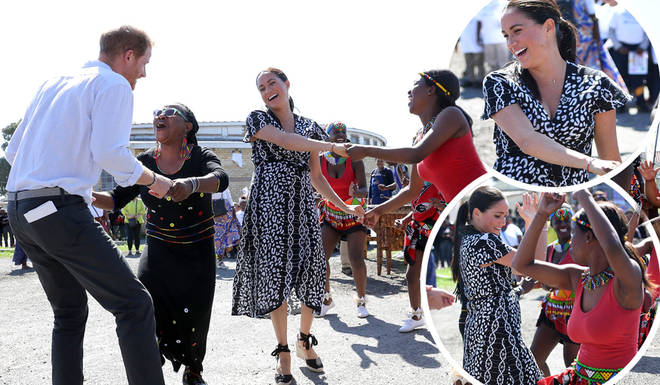The Duke and Duchess of Sussex were good sports as they joined in the dancing