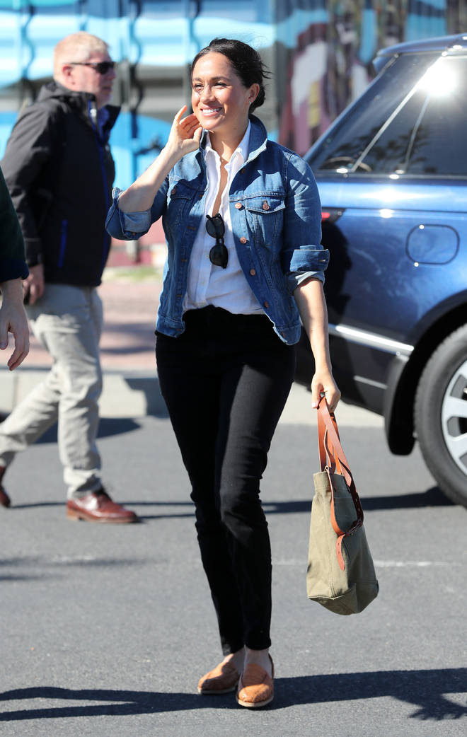 The Duchess of Sussex teamed a white shirt with a Madewell denim jacket