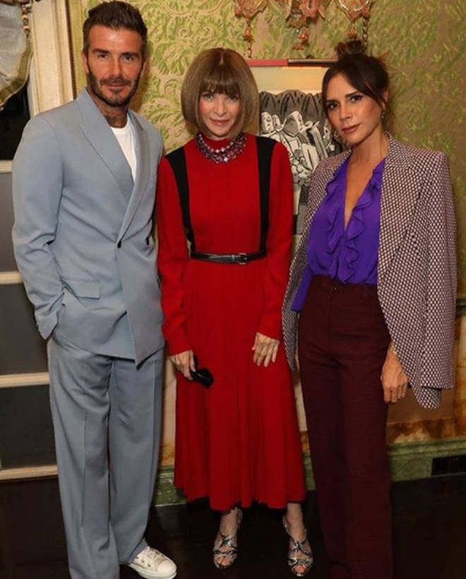 Victoria's had her implants removed since (pictured here with husband David and Anna Wintour)