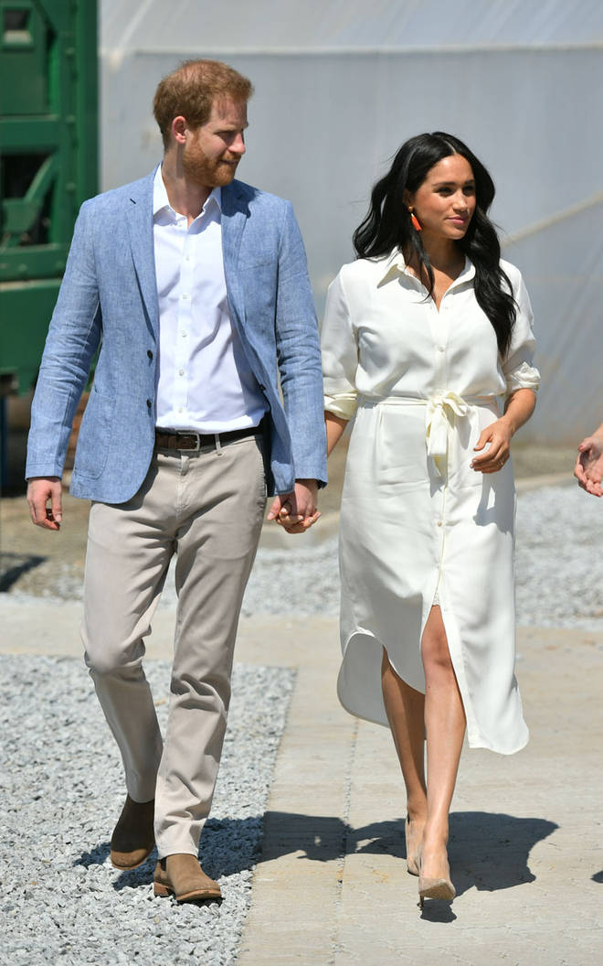 The Duchess of Sussex looked stunning in a white shirt dress for the occassion