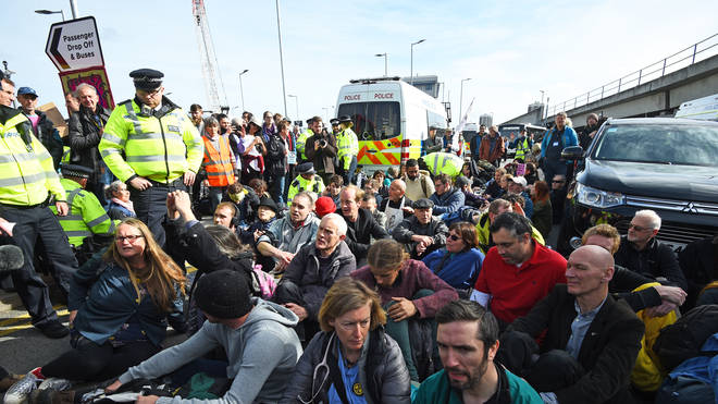 Extinction Rebellion are blocking the main entrance of London City Airport