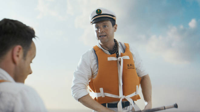 Dec looks like he's the captain of the boat and is rowing the pair