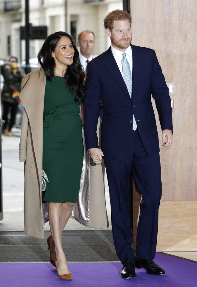 Meghan paired the dress with a light brown jacket and some tan heels