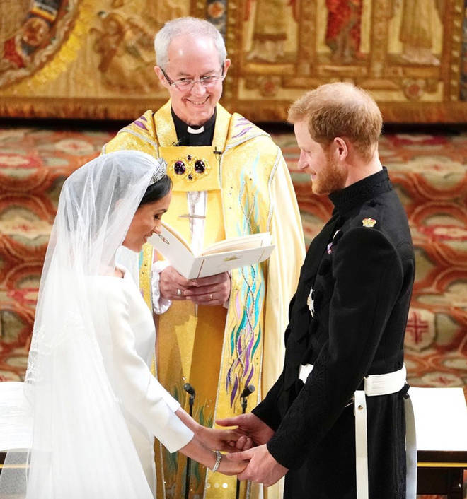 The romantic photo shows the duo exchanging vows.