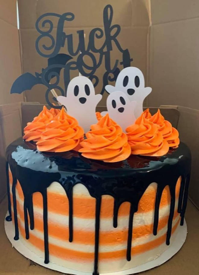 The Halloween cake topper looks like it says something very different than intended