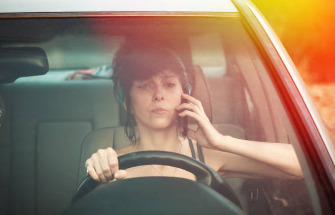 Making calls on a hand-held phone is already illegal (stock image)