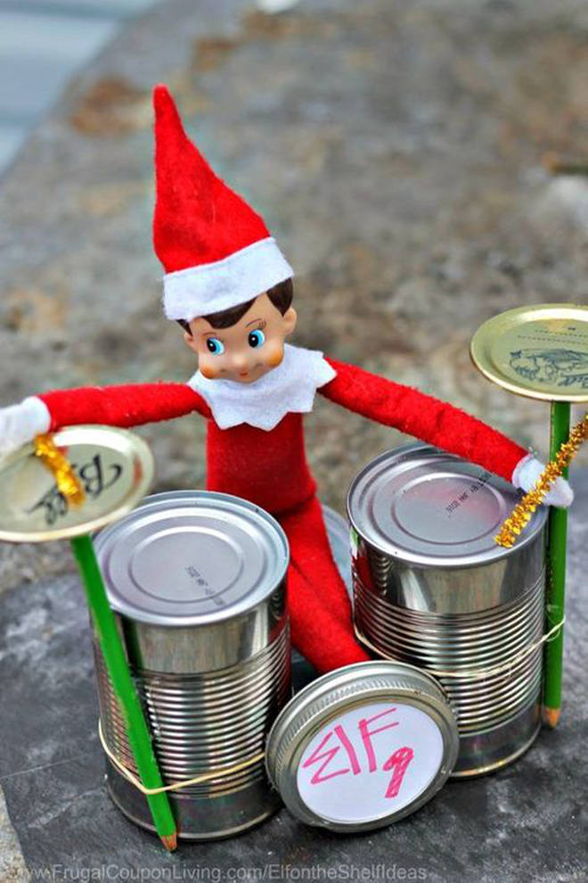 Elf practices for the rock 'n' roll Christmas carol concert.