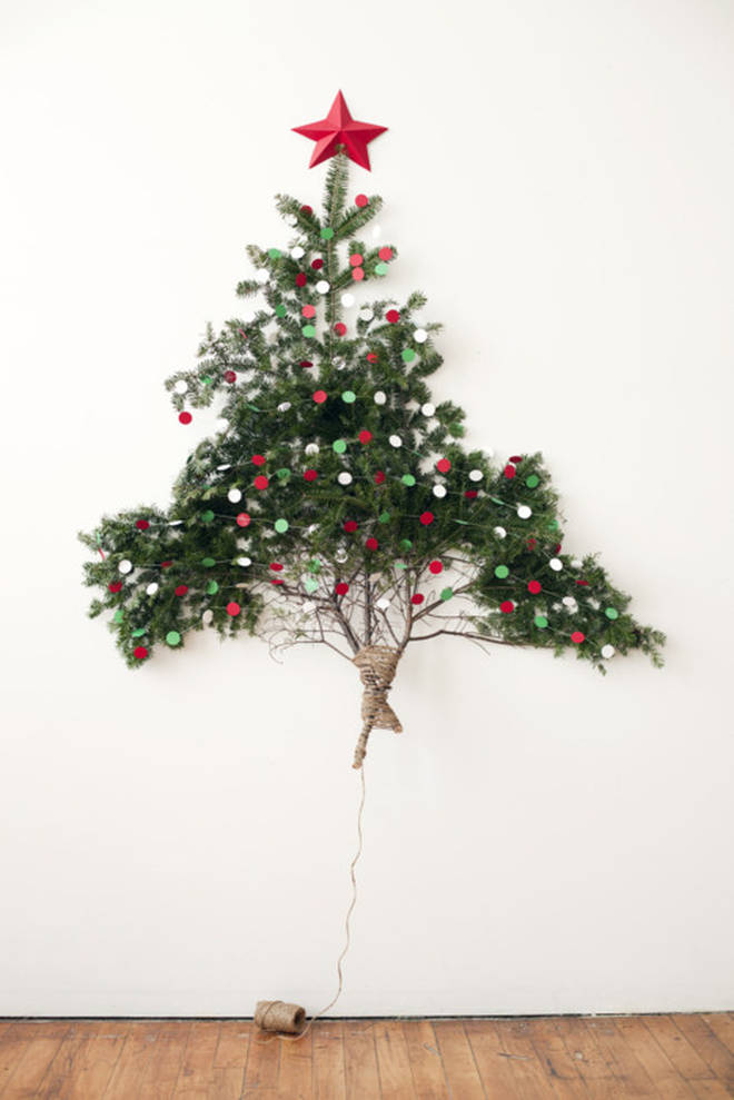 Use red and green discs to decorate the pine twigs.