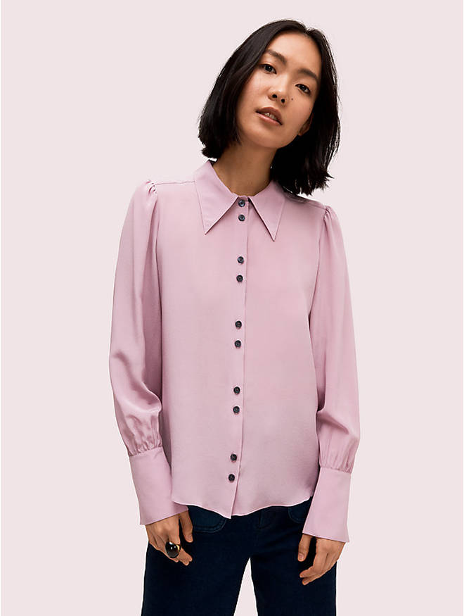 Holly's blouse is from Kate Spade