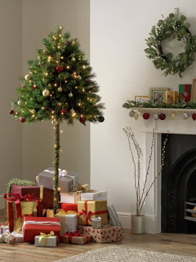 The 'Half Parasol Christmas Tree' comes in a green shade as well as white, and will cost you only £30