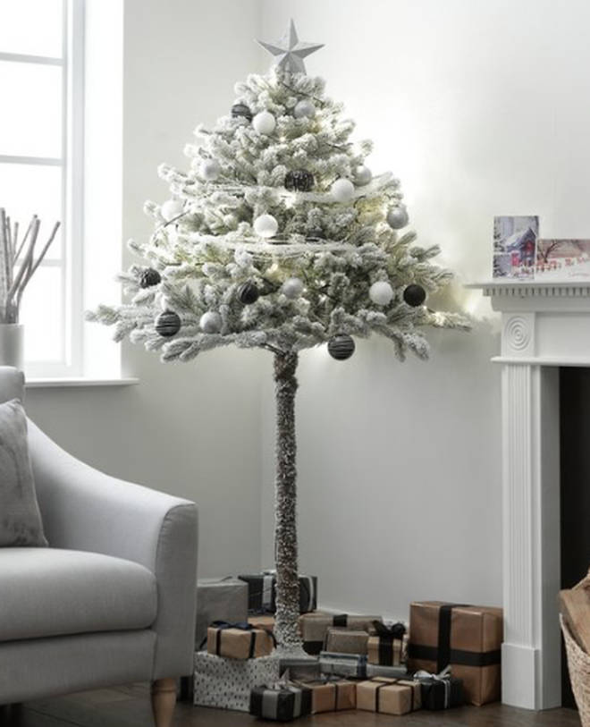 The tree has been designed with the bottom half of the tree free of pines