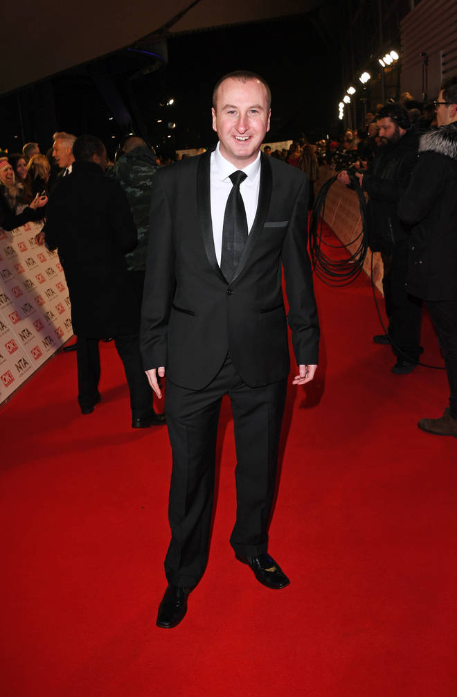 Andrew pictured looking suited and booted at a glitzy showbiz event